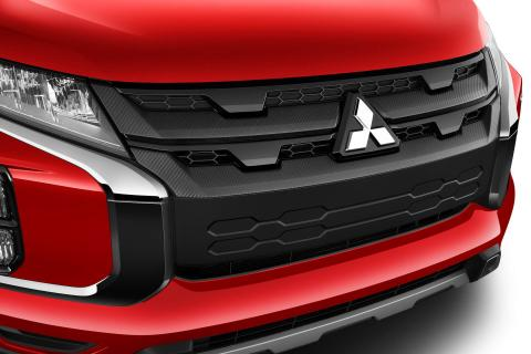 A close-up shot of carbon effect front grille on a red Mitsubishi ASX