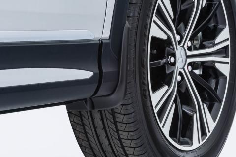 Close up of the wheel and front mud flap of an Eclipse Cross