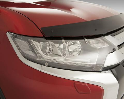 A head light protector attached on a red PHEV's head light