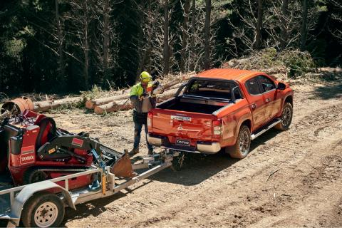 A Timeber Man and a Mitsubishi Triton VRX in forest
