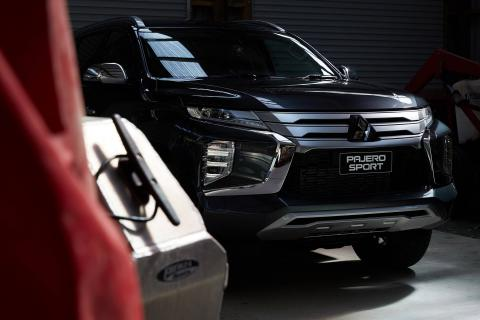 Front of a black Pajero Sport parked in garage