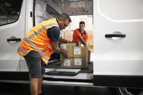 Worker offloading boxes from Express Van
