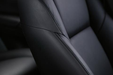A detail close up shot of black leather seat in Pajero Sport