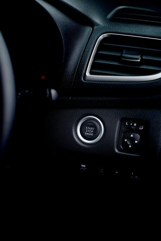 A close up of the push start ignition button of a Triton