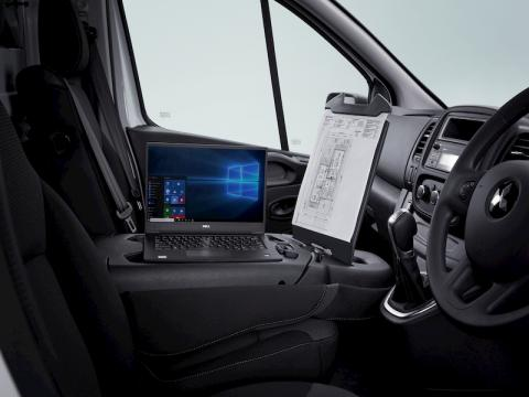 Laptop and clipboard open in the cab of Mitsubishi Express Van