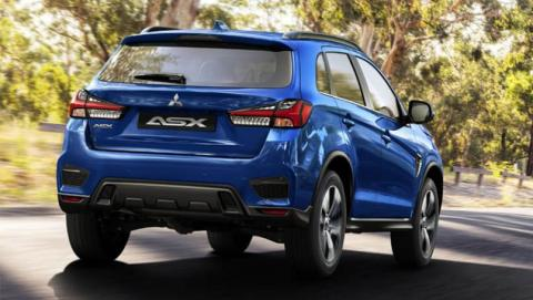 Back of a blue Mitsubishi ASX running on a country road